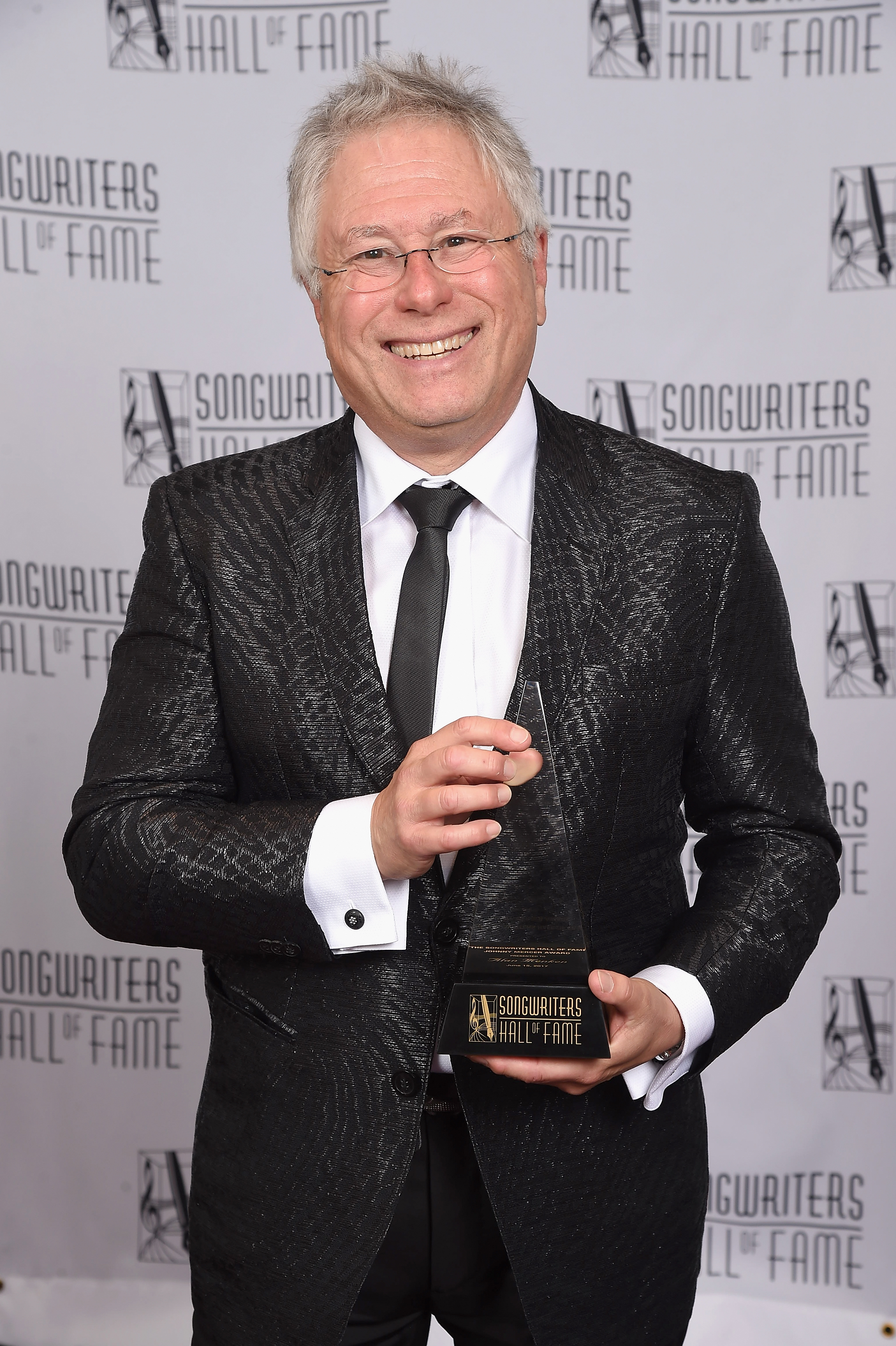 NEW YORK, NY - JUNE 15:  Johnny Mercer Award Honoree Alan Menken poses with award backstage at the Songwriters Hall Of Fame 48th Annual Induction and Awards at New York Marriott Marquis Hotel on June 15, 2017 in New York City.  (Photo by Gary Gershoff/Getty Images for Songwriters Hall Of Fame) *** Local Caption *** Alan Menken