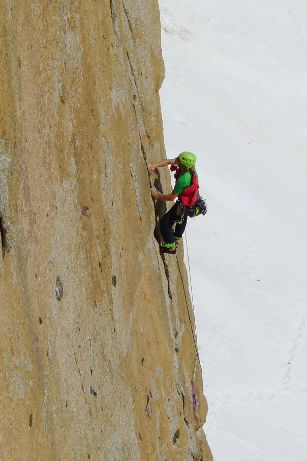 A german climber engaged with the difficulties of the lower cracks of the 'Contamine' route. Photo- Calum Muskett