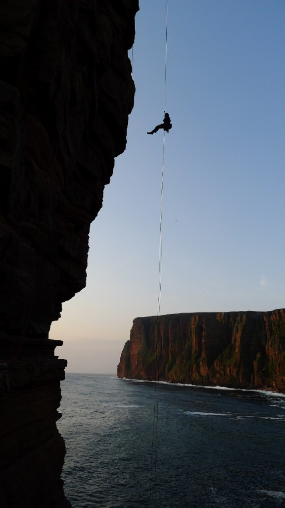 Abseil descent down the old man of Hoy. Photo- Calum Muskett