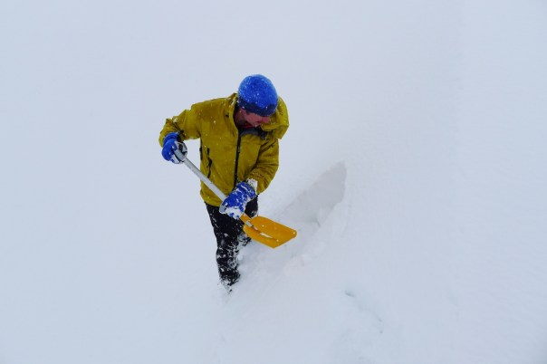 Blair digging an avalanche pit to check out the snow pack. Photo - Calum Muskett