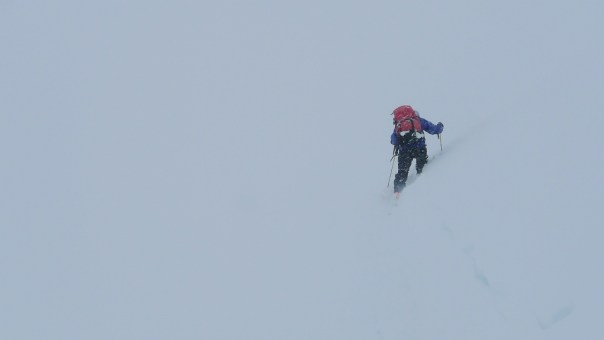 Jamie ploughing through deep powder whilst navigating on a compass. Photo - Calum Muskett