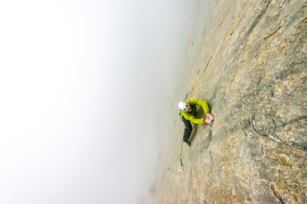 Climbing in the mist up the initial technical lower wall of Paciencia. Photo - Alexandre Buisse