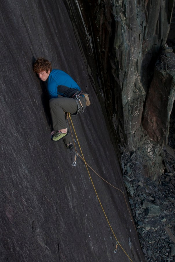 Calum Muskett climbing John Redhead's route 'Stiff Syd's Cap' E6 6b, an a-typical slate climbing experience. Photo - Mark Reeves