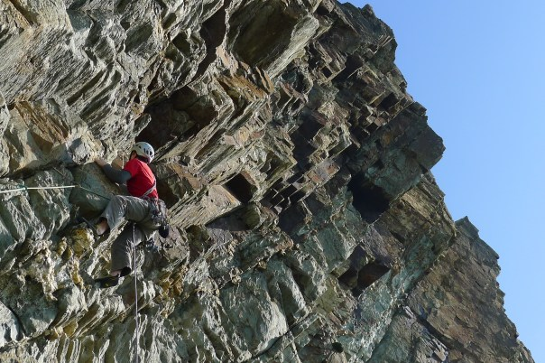 Ed Booth tackling challenging rock on the Yellow Wall classic 'Me' E6 6b. Photo - Calum Muskett