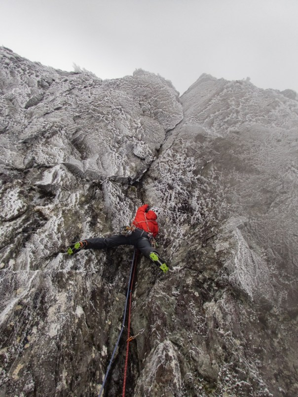 Embracing the steep mixed climbing of 'Cracking up' IX 9 on Clogwyn Du. Photo - Steve Long