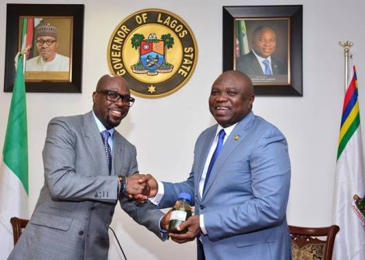 Tunde Folawiyo presented Governor Ambode with a sample of the crude oil