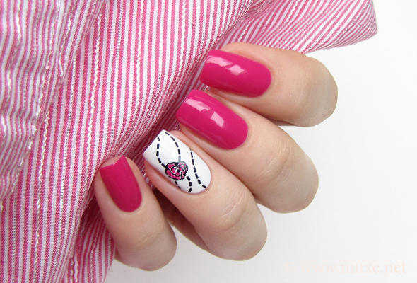 Pink nails with a flower