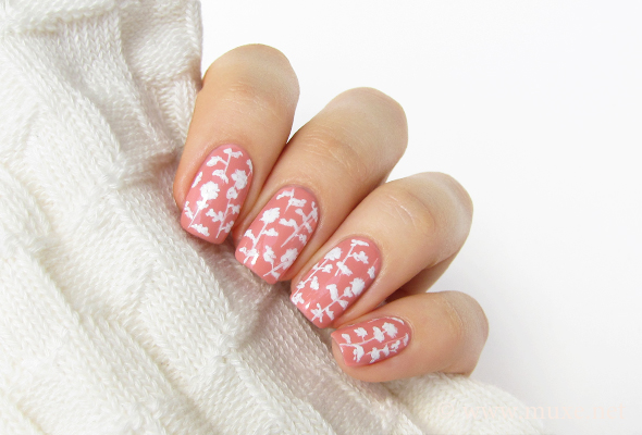 Floral nail art in pink and white