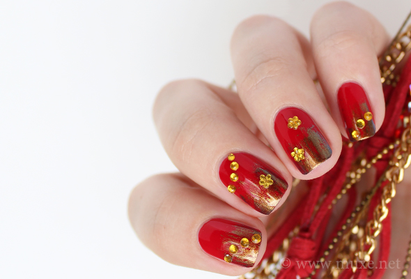 3D nail art with golden rhinestones