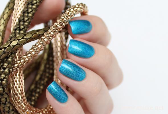 Turquoise holo nail polish