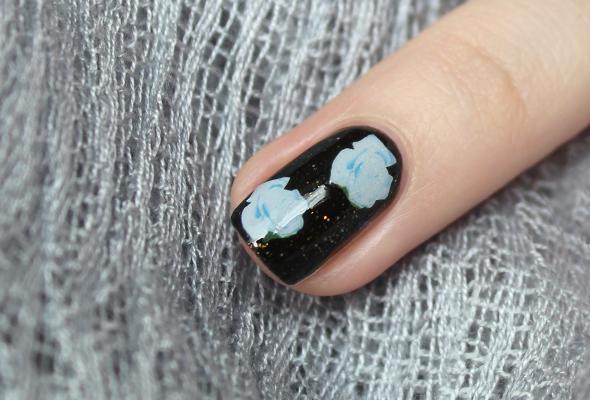 White on black floral nail design