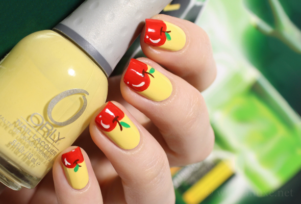 Yellow nail art with fruits