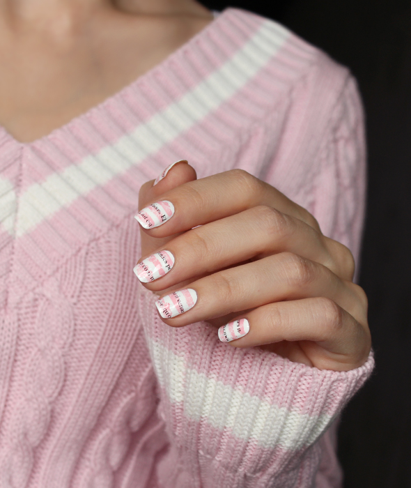 White pink nail design with stripes