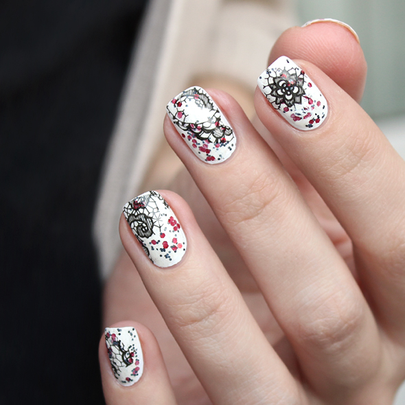 Black lace and red glitter nail design