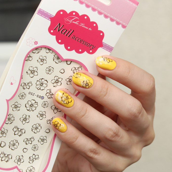 Yellow floral nails design with water decals