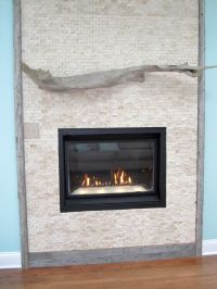 modern fireplace designs with glass on blue wall