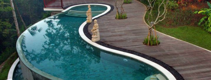 20 exquisite kidney shaped swimming pool ideas for Kidney shaped above ground pool