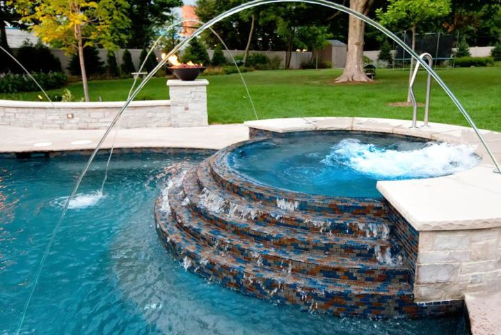 Pool with spa designs round half raised jacuzzi with art for Pool and jacuzzi designs