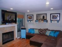 turquoise living room decor with brown sofa