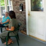 Homeowner Edith Gotlibowski, left, talks with Deborah Dozier, project construction manager with NauVEL
