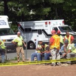 Workers stand by at Breen Field after the incident.