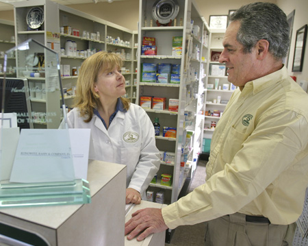 Bob Bradley, pictured here with wife and pharmacist Marion, is one of several local business owners fighting back against what they see as a growing problem in some large employers' insurance plans.