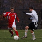 Woodland's Michael Segala (15) battles Foran's Chris Hanna (5) for possession of the ball during the Hawks' 4-3 state tourney loss on Monday in Beacon Falls.