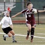 Naugatuck's Isabelle Moody controls the ball as Watertown's Jessica Spezzano moves in to try and take control Wednesday night in Municipal Stadium. Watertown defeated Naugatuck, 2-1, for the NVL title.