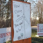 A protest sign in Prospect compares the size of proposed turbines to residential homes.