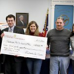 From left, Elner Morrell, Connecticut Community Foundation grants committee volunteer, Josh Carey, Conn. Community Foundation program officer, Allison Sirowich, Parks and Recreation commissioner, Erin Schwarz, town clerk, and Joe Rodorigo, Parks and Recreation commissioner pose with a giant check.