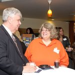 Jeff Chipokas, President of the Naugatuck YMCA board and Michele McDougallm also from the YMCA, talk during the Naugatuck Savings Bank Awards reception May 11. The YMCA received $3,037 in grants from the bank.