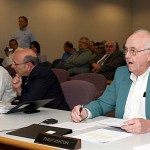 Siting Council member Philip Ashton speaks during the council's meeting May 12 in New Britain. The council voted 6-2 to deny BNE's petition to build two wind turbines in Prospect.