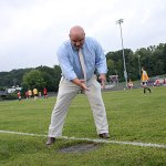 Athletic Director Tom Pompei points to a drain on the edge of the Naugatuck High School soccer field. Drains and sprinklers in the field violate safety codes for players.