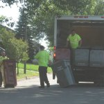 A public works crew delivers 96-gallon trash and recycling bins Wednesday to homes on Celentano Drive. RA ARCHIVE