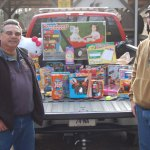 Naugatuck firefighter Rich Tavares, left, and Anthony Recchia Jr., coordinator of the toy drive for the High Rock Shooting Association showoff some of the toys collected over the past two weekends Saturday. KEN MORSE