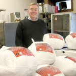 Mike Kelly is helping to organize a free Christmas dinner hosted by the Ecumenical Conference of Churches of Naugatuck and Beacon Falls. This year, Kelly and the other volunteers are preparing 513 pounds of turkey to go along with ham and plenty of sides for the meal.