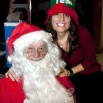 Santa, played by Robert Juilano of Naugatuck and Michele Hackett of Prospect, have been volunteering their time to hand out gifts to children for seven years during the annual Community Christmas Dinner Sunday at St. Michael's Episcopal Church in Naugatuck. RA ARCHIVE