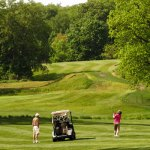 A pair play a round of golf last May at Hop Brook Golf Course in Naugatuck. The pro shop opened Thursday. -RA ARCHIVE