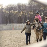Kayla Magnarella, 9, is one of nearly two dozen children who are enrolled in horseback riding at Hidden Acres Therapeutic Riding Center in Naugatuck. The organization received a $10,000 grant from Connecticut Community Foundation so it can continue to offer the services to families who have disabled children, regardless of income. –RA ARCHIVE