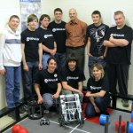 Members of the robotics team at Woodland Regional High School in Beacon Falls pose with their robot that they will take to the world robotics competition in Anaheim, Calif., next month. Team Impulse, back row from left, Ryan Leeper, 15, Jacob Hawes, 17; Alex Smith, 17; Dan Lyons, 18; Mark Mierzejewski, a physics and astronomy teacher at the school; Jerry Zollo, 17; and Chris Bailey, 18. Front row from left, Arty Kica, 17; Zach Blum, 18; and Marianna Majewska, 17. –RA ARCHIVE