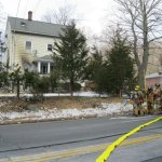 Naugatuck firefighters work at a structure fire at 504 Prospect St. in Naugatuck Feb. 25. Raeann Goss, 75, has been charged with arson in connection with the fire. –RA ARCHIVE