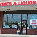 """A large """"Open Sunday"""" sign hangs in the store front of Mount View Wines & Liquor in the Mount View Plaza in Naugatuck after Gov. Dannel Malloy signed Sunday liquor sales into law earlier this week. –RA ARCHIVE"""