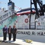 From left, Naugatuck High School graduate Michelina Cioffi, Class of 2009, Naugatuck High biology teacher Beth Lancaster, and Science Department Chair Gena Spiller stand in front of the coastal mapping vessel Ferdinand R. Hassler during a christening ceremony last month in Norfolk, Va. Four of Lancaster's former students won an essay contest to name the ship in 2007. –CONTRIBUTED