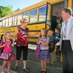 Maple Hill Elementary School music teacher Bob Trosan and paraprofessional Angie Pavone welcome students as they arrive for their first day of school Wednesday morning. The Naugatuck school is taking on more than 150 additional students this year due to the conversion of Central Avenue Elementary into a preschool. –RA ARCHIVE