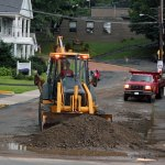 Workers clean up at the intersection of Hillside Avenue and Meadow Street in Naugatuck following flooding Aug. 1. The borough is seeking state funds to make drainage repairs in areas throughout Naugatuck. –FILE PHOTO