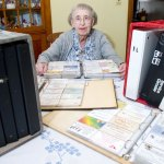 Inez Bramhall of Prospect displays a portion of her business card collection in 2007. Bramhall, a longtime, well-known volunteer in Prospect, died Sept. 16 at the age of 94. RA ARCHIVE