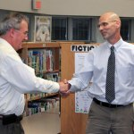Woodland Regional High School Principal Arnold Frank, left, congratulates Woodland physics teacher Mark Mierzejewski on being named Region 16's 2013 Teacher of the Year during a ceremony Sept. 12 at Laurel Ledge Elementary School in Beacon Falls. –ELIO GUGLIOTTI