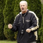 Woodland cross country coach Jeff Lownds cheers on his team during a meet last year. Lownds, who has coached at Woodland since it opened in 2001, was recently honored by the Danbury Old Timers. –RA ARCHIVE