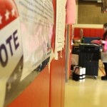 Jamie Litvaitis votes at Maple Hill Elementary School in Naugatuck in November 2012. This year people who haven't registered to vote can do so on Election Day.  –RA ARCHIVE