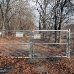 A locked gate, with 'No Trespassing' signs blocks public access to the Naugatuck State Forest at the end Cold Spring Road in Beacon Falls. The road was closed off in May and was supposed to be reopened in September. However, the state Department of Transportation feels that the road is unsafe and plans to keep it closed indefinitely. –LUKE MARSHALL